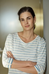 Woman leaning against wall portrait