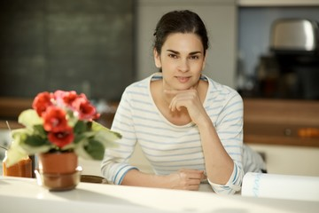 Portrait of attractive casual woman at home