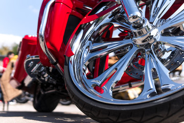 Motorcycle close-up. Detail of a beautiful powerful chrome motorcycle wheels. The concept of freedom and travel. custom works. Metallic shiny new internal combustion engine Wall mural