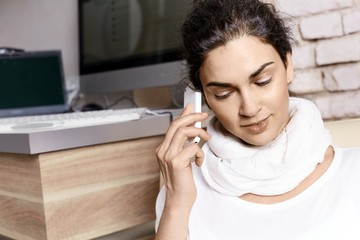 Young adult woman on the phone at home