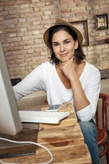 Portrait of smiling fashion blogger woman at home