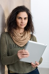 Portrait of woman holding tablet in hand