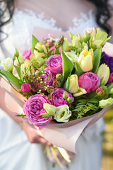 Wedding bouquet with roses and tulips