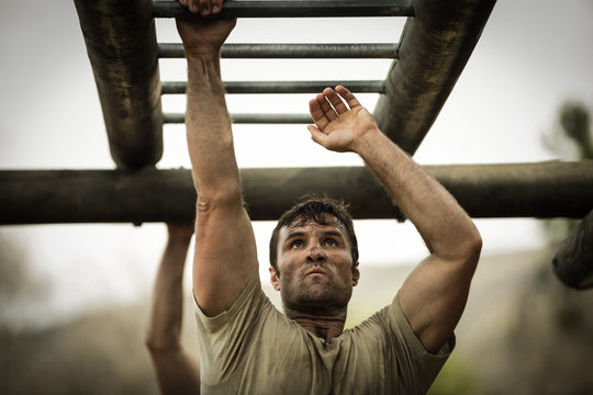 Soldier climbing monkey bars