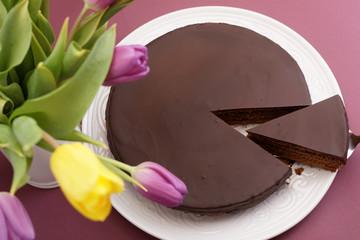 Chocolate cake and tulips