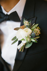 Close-up of a groom wearing tuxedo with boutonniere