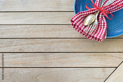 A Red White and Blue Picnic Table Place Setting with napkin ...