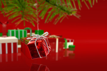 Composite image of Red christmas decoration hanging from branch against red vignette