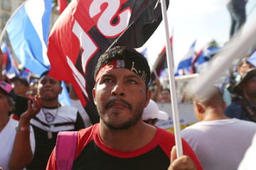 A man participates in the Sandinista National Liberation Front (FSLN) May Day rally in Managua