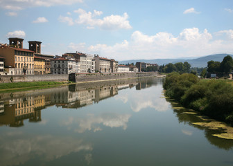 Reflections in the Arno River in Florence, Italy