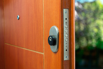 Open door of a family home. Close-up of the lock an armored door. Security.