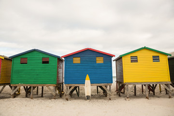 Multi colored wooden huts on sand at beach