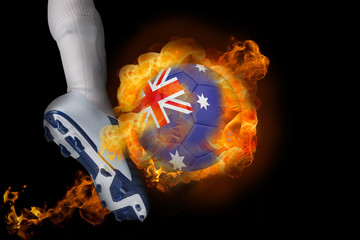 Football player kicking flaming australia ball against black
