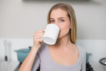 Calm gorgeous model drinking from mug