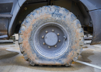 Deflated damaged tyre on truck wheel