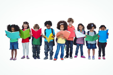 A row of children standing together reading books