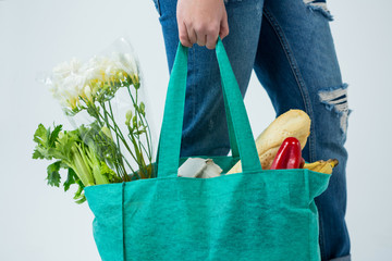 Woman carrying grocery bag