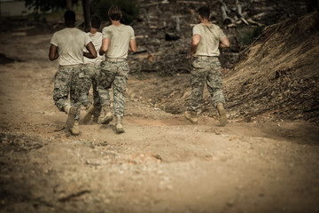 Soldiers running in boot camp