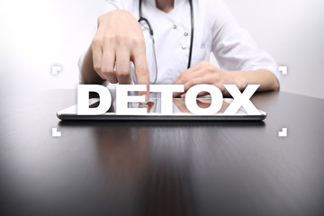 Medical doctor select detox on virtual screen. Health Care concept.