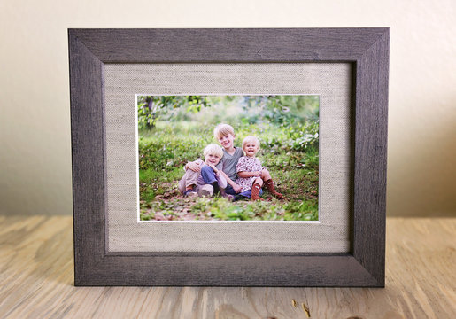 Rustic Wood Framed Portrait of a Family of Three Children Outside