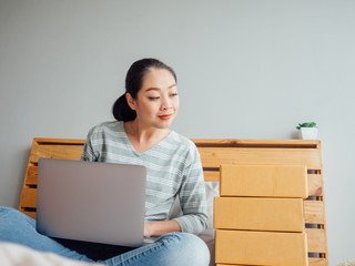 Online business owner woman check her product stock in bedroom.