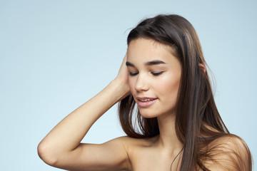 woman with closed eyes, dark hair