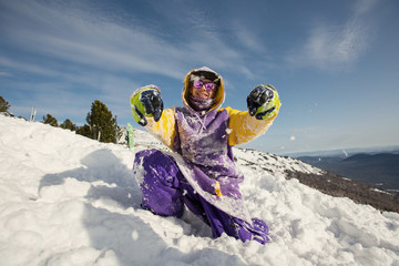 Guy have fun and playing on snow mountain top. Snowboard, freeride and winter holiday
