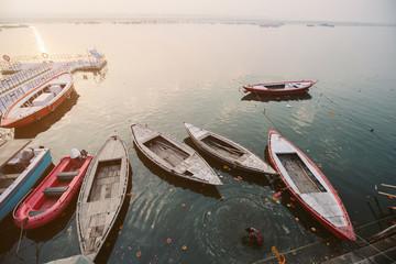 Old boats and swimming in Ganga river, Varanasi, India