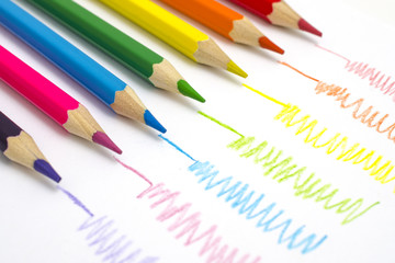 set of colored pencils with doodles isolated on white