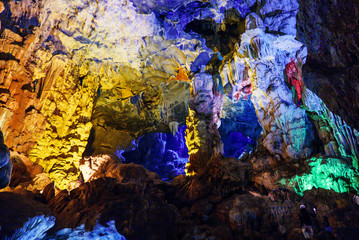 Colorful inside of Hang Sung Sot cave world heritage site in Halong Bay, Vietnam