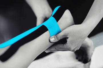 Achilles Tendon Treatment With Blue Kinesiology Tape