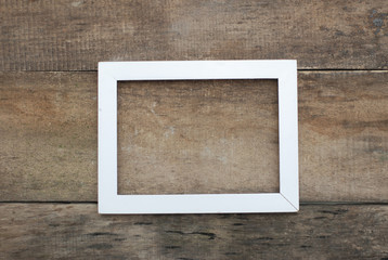 Empty White Picture Frame Old rustic Wooden wall floor. copy space.