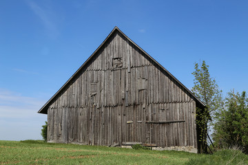 Old wooden shed in the middle of the field