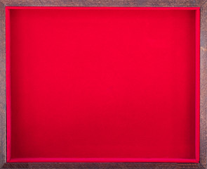wooden frame on a red background