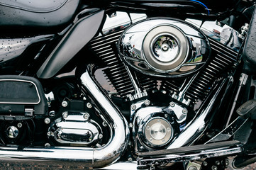 Closeup of motorbike with lots of chrome details. Modern powerful perfomance road motorcycle shiny reflexive surface engine with exhaust pipes.  Vehicle industry.  Two-wheeled vehicle technologies. Wall mural