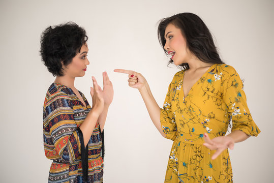Two women arguing and distrusting each other