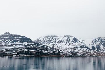 Rocky range in snow above lake