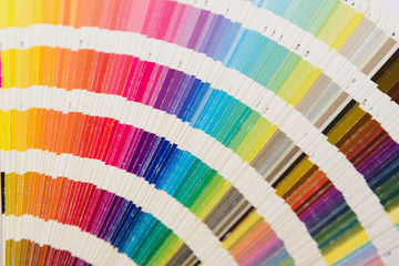 A used Fanned array of color printing swatches