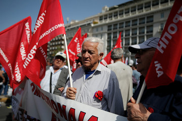Greek Communist Party supporters take part in a rally commemorating May Day in Athens