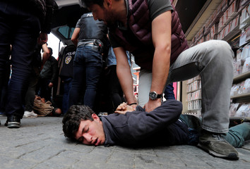 Turkish police detain protesters as they attempted to defy a ban and march on Taksim Square to celebrate May Day in Istanbul