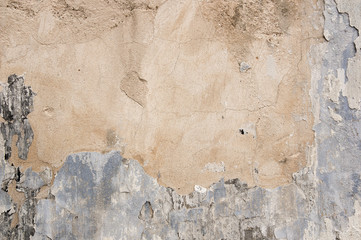 Abstract vintage textured old painted wall with stained and shabby uneven plaster  background