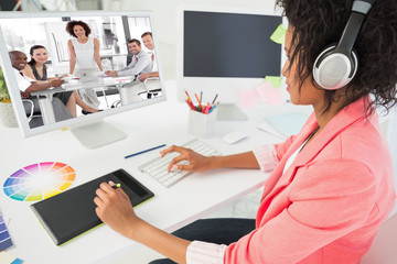 Female business woman giving a presentation  against casual female photo editor using computer