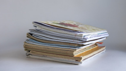 a stack of different notebooks