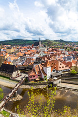 View over Krumlov in Bohemia with lake Vlatva