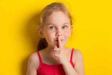 Kid making silence gesture
