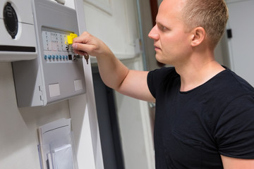 IT Technician Opening Fire Panel In Datacenter