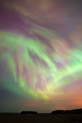 Aurora Borealis, Northern lights, in the cold autumn sky in Finland.