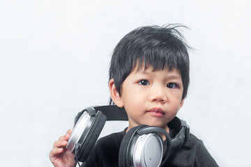 Cute Little Boy with  Headphone on White Background.