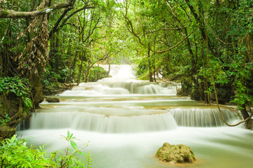 Wonderful  tiers of waterfall motion in deep jungle, Located Erawan waterfall Kanchanaburi province, Thailand