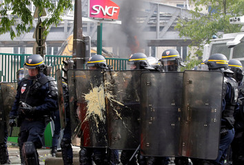 French CRS riot police take position during clashes at the May Day labour union march in Paris